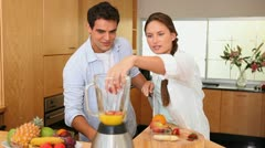 Stock Video Footage of Couple putting fruits into a blender