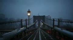 Brooklyn Bridge glide in winter fog, New York City - stock footage