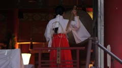 Japanese priestess (miko) at a temple in Kyoto Stock Footage