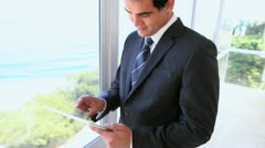 Man in suit using a tablet computer Stock Footage