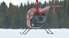 Red Helicopter Menacing Fleeing Dogsled Team Stock Footage