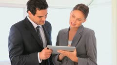 Business people looking at a tablet - stock footage