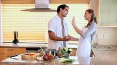 Couple arguing in the kitchen Stock Footage