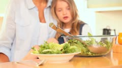 Mother and daughter mixing the salad Stock Footage