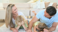 Happy family lying on the front Stock Footage