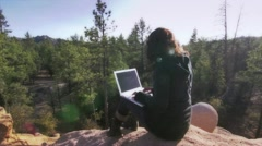 Working with lap in hight mountain Stock Footage
