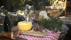 Typical Italian food with ham, cheese, salami and wine - stock footage