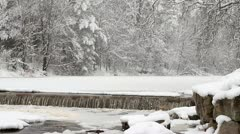 Heavy Snow on Frozen River - stock footage