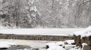 Heavy Snow on Frozen River Stock Footage