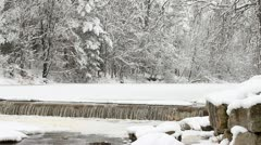 Fresh Snow on Frozen River Waterfall - stock footage