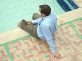 Stock Video Footage of Businessman texting sms on mobile phone by the pool