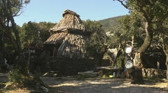 Traditional hut used as animal pen in Sardinia, Italy Stock Footage