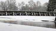 Pan of Snow Covered Rustic Foot Bridge Stock Footage