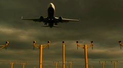 Passenger jet coming into land overhead, with runway lights in view.1 Stock Footage