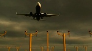 Stock Video Footage of Passenger jet coming into land overhead, with runway lights in view.1