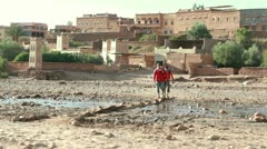 Stock Video Footage of Couple walking across stream