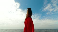 Stock Video Footage of Woman In Red Dress Walking Down Pier