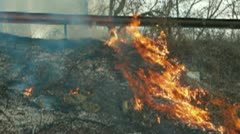 Grass Fire On The Roadside - stock footage