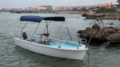 a small white boat with a fishing reel for the grid - stock footage