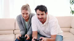 Young woman wining a game against her boyfriend Stock Footage