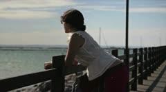 Girl watching panorama ocean Stock Footage
