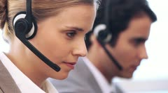 Call centre agent working with a headset Stock Footage