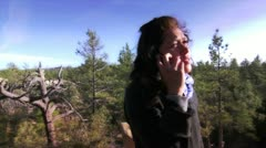 Girl talking with phone in natural park Stock Footage