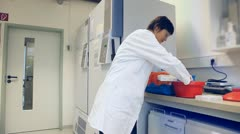 Cryogenics lab, Fridge with frozen samples in a sperm bank Stock Footage