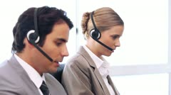 Call centre agents working in their office - stock footage
