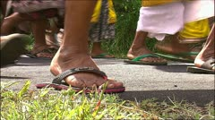 Procession of flip-flops - stock footage