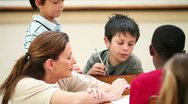 Teacher talking with her pupils Stock Footage