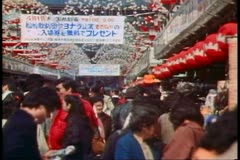 Stock Video Footage of The Asakusa district in Tokyo with milling crowds