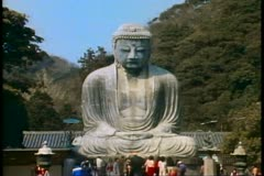 The Kamakura Buddha of Japan, people in foreground, wide shot - stock footage