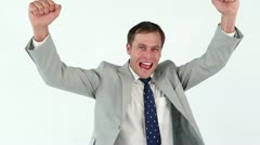 Happy businessman raising his fists in success Stock Footage