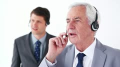 Serious businessmen using headsets Stock Footage