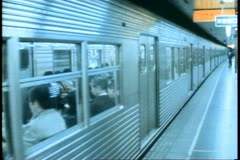 The Tokyo Subway, train leaves station Stock Footage