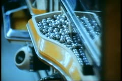 Pachinko Parlor in Tokyo, balls dropping into the tray Stock Footage