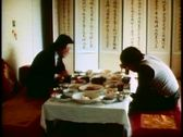 Two men have a traditional Korean lunch at low table using chopsticks, Stock Footage