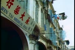 Laundry hanging from a window, Singapore, Chinese signs Stock Footage