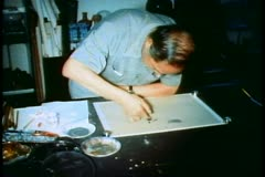 Man figure painting Chinese character, calligraphy, in Singapore Stock Footage