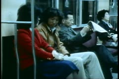 The Tokyo Subway, a group of people inside the train Stock Footage
