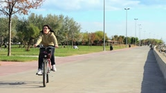 Riding bicycle - stock footage