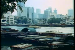 Singapore inner harbor, junks, old wooden boats Stock Footage