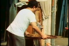 Man tosses rice in a basket to remove chafe in a Singapore market Stock Footage