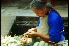 Old woman in market in Singapore Stock Footage