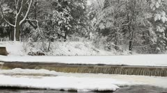 Pan of Fresh Snow on Frozen River Waterfall - stock footage