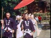 Shinto priests with large umbrella pass in a ceremony, Kamakura in Japan, Stock Footage