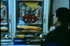 Pachinko Parlor in Tokyo, people playing the pinball machines Stock Footage