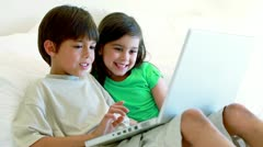 Stock Video Footage of Peaceful siblings using a laptop
