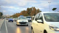 Cars drive on the road at dusk Stock Footage